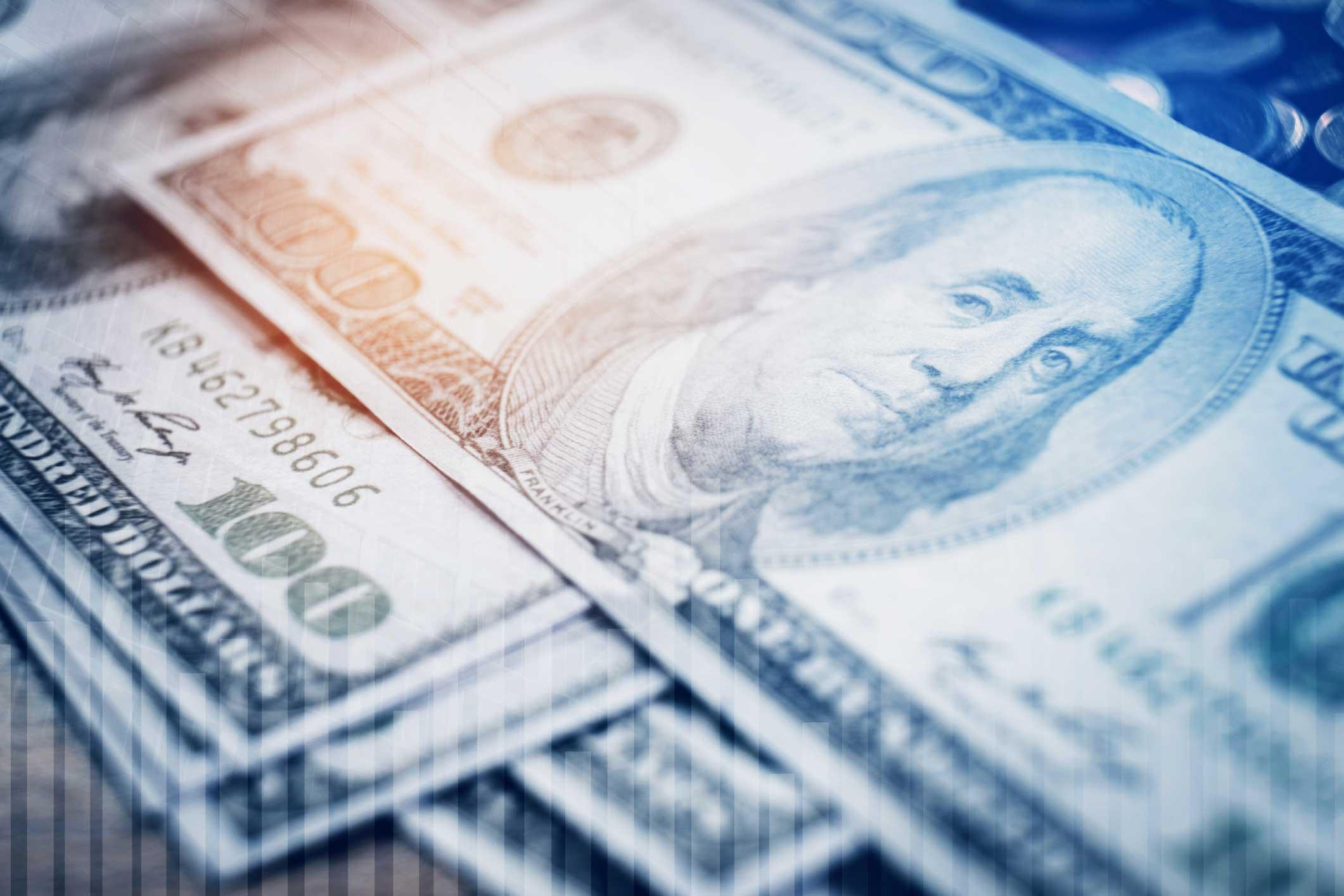 hundred dollar bills, blue background