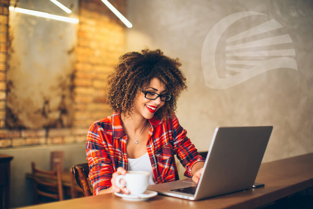 happy female checking laptop with coffee, NAUPA icon