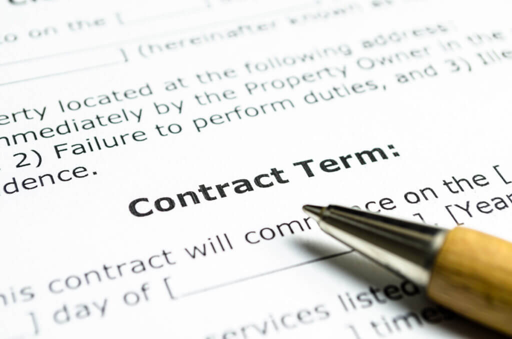 contract term document with pen