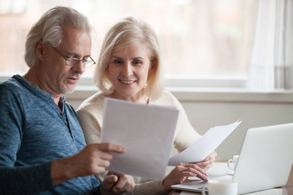 senior couple reviewing letters at home